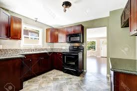 Black and white ceramic tile floor Checkerboard Fake Wood Flooring Idea In Brown White Ceramic Tile Floor Modern Dark Wood Cabinet Kitchens With Black Appliances And Black Countertops Stainless Steel Blazen Kennels Fake Wood Flooring Idea In Brown White Ceramic Tile Floor Modern