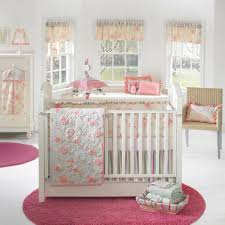 entrancing design baby girl nursery ideas with white color wooden baby crib and white pink peach colors fl pattern bedding set