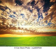 grass field sunset. Sunset Over Green Grass Field - Csp8287630