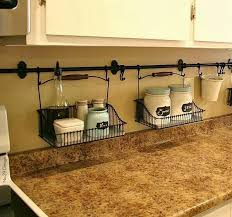 By hanging curtain rods and holders, you're able to eliminate the clutter  on your kitchen counter. Easy clean ups! kitchen storage ideas, kitchen  organizing ...