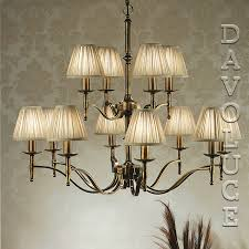 stanford 12 light chandelier brass by viore disign designer paul mulhearn wall lights by