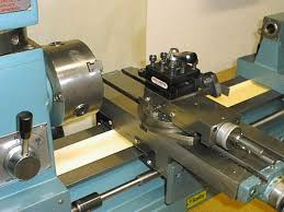 drill press metal lathe. figure 4: close up of carriage, cross-feed and tool post. drill press metal lathe