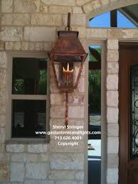 hill country style home with gas lanterns traditional