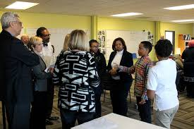 university leaders meet with students and staff at city garden montessori charter school