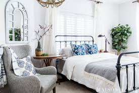 mostly white bedroom with pops of blue for spring summer looking to