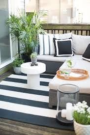 Outdoor furniture for apartment balcony Cute Balcony The Everygirl Cofounder Danielle Moss Chicago Apartment Tour theeverygirl Outdoor Patio Balcony Ideas Cofounder Danielle Mosss Scandinavianinspired Apartment