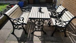 rare antique newly refurbished 5 piece cast iron garden table and chairs
