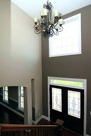 12 light faux candle chandelier country farmhouse two story foyer with glass front doors hardwood st