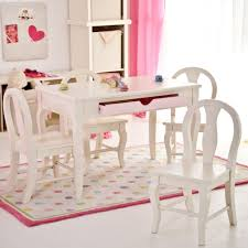 white wooden kids table with drawer and four chairs set for girls of