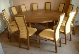 fumed oak and yew extending round table and chairs