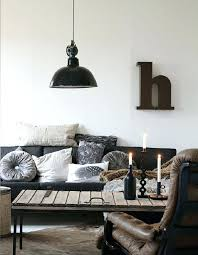 cool industrial themed living room black couch grey cushions leg wooden stripes table lamp style for
