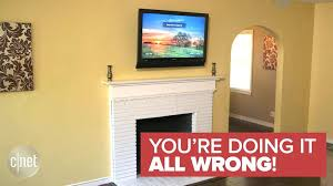 you doing it all wrong tv mount above fireplace mantel hanging over without studs on existing