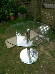 round glass and chrome dining table