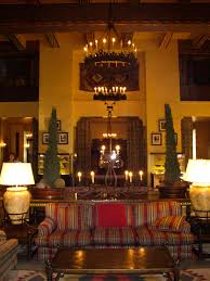 the grand fireplace lit room of yosemite park s ahwahnee hotel replete with autumn colors