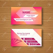 Blank Business Card On A Wooden Table With A Multi Colored Ornament