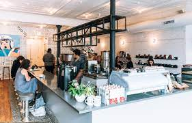There is a large communal table at the center of the room but also a few private small tables. Intelligentsia Coffeebars Our Locations Intelligentsia Coffee