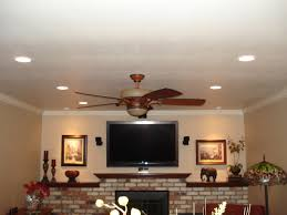 living room living pendant lighting incandescent recess lights wall wash with lighted ceiling fan on