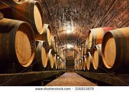 stacked oak barrels maturing red wine. Rows Of Oak Barrels In Underground Wine Cellar Stacked Maturing Red R