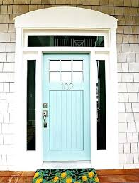 front door with transom above a wooden powder blue front door with glass panels on either front door with transom above