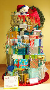 Christmas tree made out of Christmas presents gift wrapped boxes
