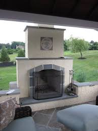 stucco fireplace tile accents