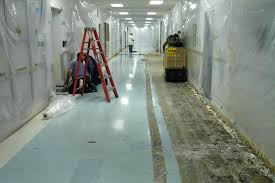 remove industrial tile and re concrete floor before removing adhesive from glue wall