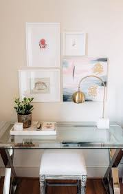 Home office small gallery home Blue Chic Home Office Space With Glass Desk Gold Desk Lamp And Small Gallery Wall Pinterest Chic Home Office Space With Glass Desk Gold Desk Lamp And