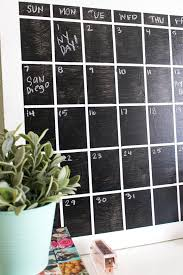 remove the tape to reveal the calendar grid use the chalk to write in the days of the week at the top and number each box according to the date