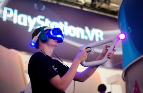 sony vr headset. a visitor try out vr game at the sony play station stand gamescom vr headset 1