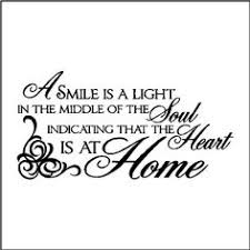a smile is a light in the middle of the soul indicating that the heart is at home