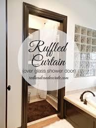 ruffled curtain over glass shower door
