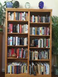 Travel books, fiction, and a lot of nonfiction. It's almost entirely double-stacked.  Can you spy my beloved copy of CMOS (Chicago Manual of Style)?