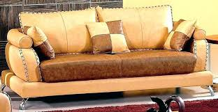 camel colored leather sectional qualified sofa top color with two toned couch cover
