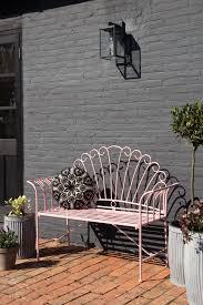 pretty pink metal garden bench