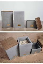 I love these <b>concrete</b> and wood <b>storage boxes</b>. The little copper ...