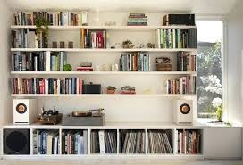 Modern office shelving Stylish Wall Of Shelving About Seven Feet Tall And Wide Keeps Reference Modern Office Shelves Shelf Inmod Wall Of Shelving About Seven Feet Tall And Wide Keeps Reference