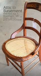 eastlake chair with burled wood and a cane seat