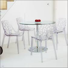 modern dining room design with unique lucite chairs and glass round dining table plus lucite furniture