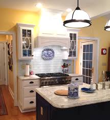 kitchen backsplash glass tile white cabinets. Marvelous Glass Subway Tile White Kitchen Backsplash With Antique Half Egg Pendant Lamps Over Island In Yellow Designs Cabinets