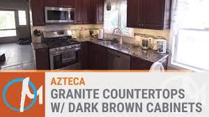 azteca granite counters with dark brown
