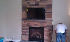 white wall also brick fireplace and mounting tv above fireplace plus tile flooring for contemporary living