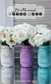 diy distressed mason jars using acrylic paint a nail file and sprayed with a coating of water resistant scratch resistant matte enamel protective coat
