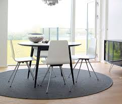 danish retro round dining table shown in white and black