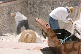 concrete with plaster or aggregate finishes workmen repairing a pool