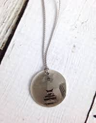 sterling litho solrs and sailors monument necklace emily sch collection silver in the city