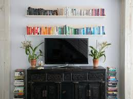 eclectic black entertainment center with floating shelves