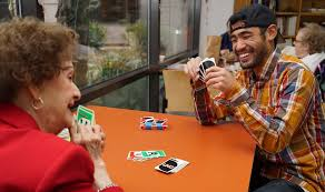 Image result for free pictures volunteer play cards with senior