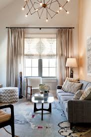 chevron roman shades living room transitional with round area rug patterned rug round area rug