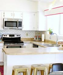 painted white kitchen cabinets before and after. Painted White Kitchen Cabinets With Tile Backsplash And Gold Stools Painted Before After