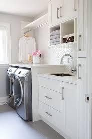 small laundry room glass mosaic backsplash white cabinets grey floor tiles barlow